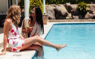 Friends chatting by the pool