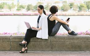 Businesswoman working on her laptop in the park.