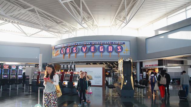 Passengers arriving at Las Vegas' McCarran International Airport