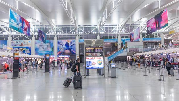 Travelers checking in at New York's John F Kennedy International Airport