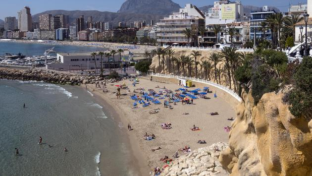 Sunbathers in Benidorm, Spain