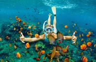 A young girl snorkeling in Hawaii