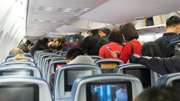 Crowded airplane cabin in Los Angeles