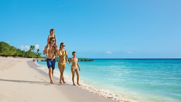 Family walks on the beach
