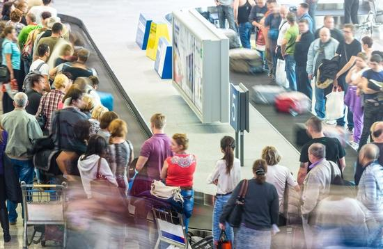A busy airport baggage claim area