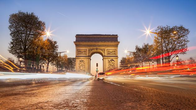 Arc de Triomphe at night in Paris, France