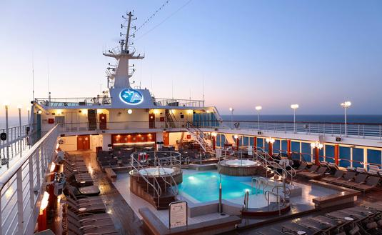 Pool deck at sunset, Azamara Club Cruises