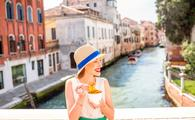 Traveler enjoying Italian street food in Venice
