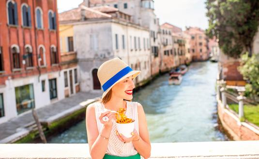 Traveler enjoying Italian street food in Venice