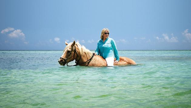 Martha Stewart horseback riding in the Caribbean.