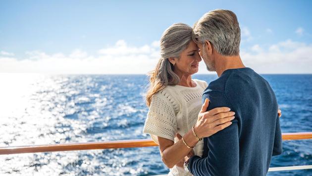 A couple sharing a romantic moment aboard Seven Seas Navigator, Regent Seven Seas Cruises