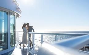 A couple enjoying a romantic moment aboard Seven Seas Navigator, Regent Seven Seas Cruises