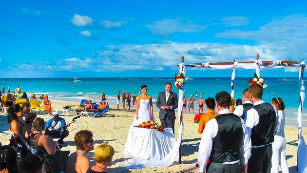 A wedding ceremony takes place on a beach in Punta Cana, Dominican Republic
