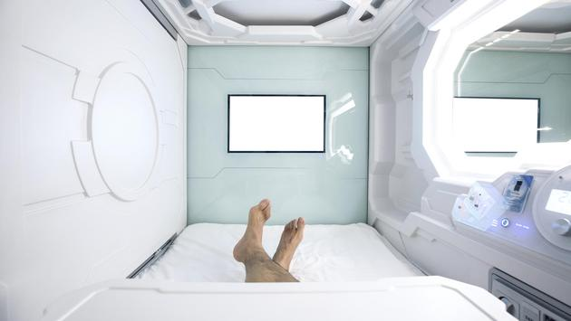 man sleeps in the capsule hotel