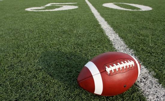 An American football at the fifty-yard line