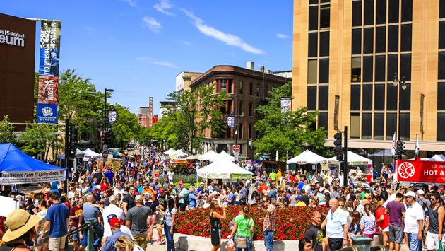 Crowds of people at a weekend farmers market in Downtown Madison, Wisconsin