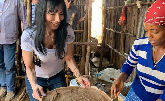 preparing injera bread in Ethiopia