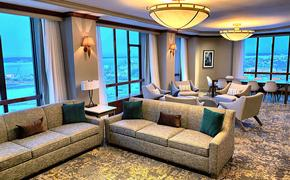Hotel suite with view of Anchorage port in snow