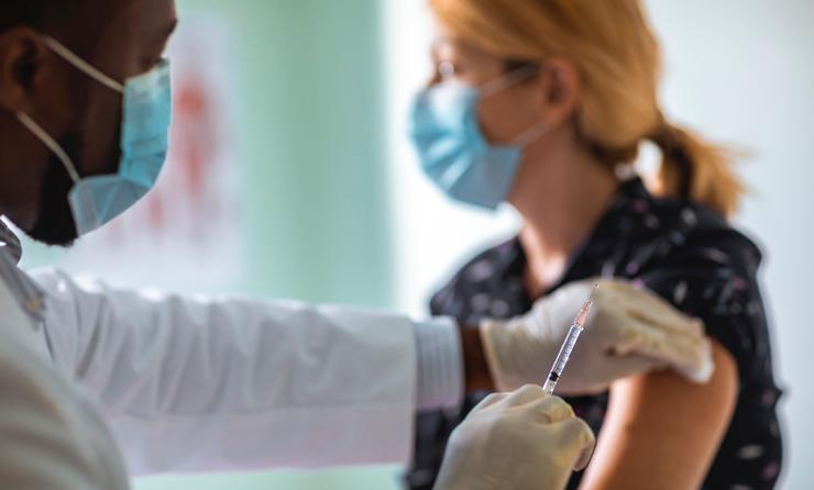 Young woman getting vaccinated against COVID-19.