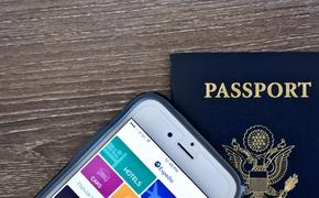 Passport and iPhone with expedia app