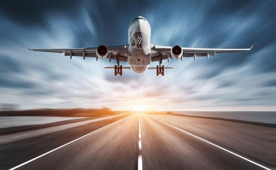 Airplane and road with motion blur effect at sunset