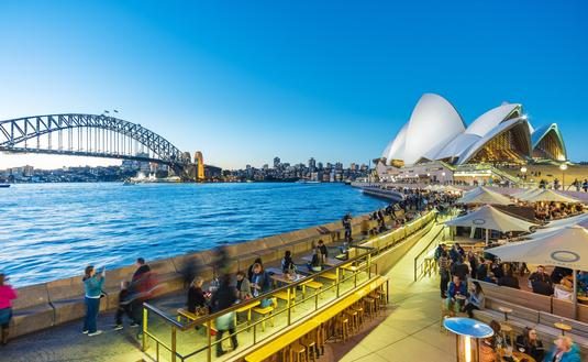 People dining outdoors at Sydney's Circular Quay