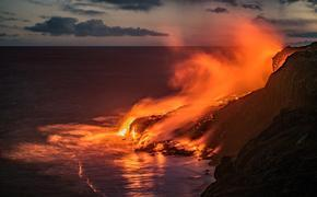Lava flows into the Pacific Ocean from the Kilauea volcano, along on the south coast of the Big Island of Hawaii.