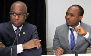 Hugh Riley and Dominic Fedee address a Caribbean Tourism Organization press conference in Toronto.