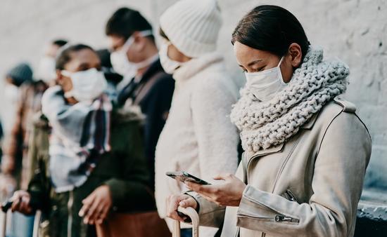 Travelers wearing face masks.