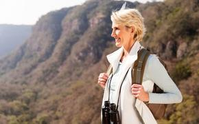 Beautiful hiker enjoying the view from top of a mountain. (photo courtesy of michaeljung/ iStock/ Getty Images Plus)