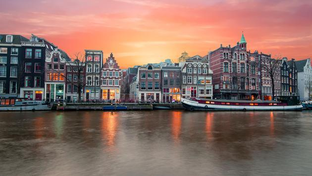 Amsterdam at the river Amstel at sunset in the Netherlands