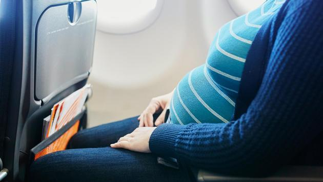 Pregnant woman on plane