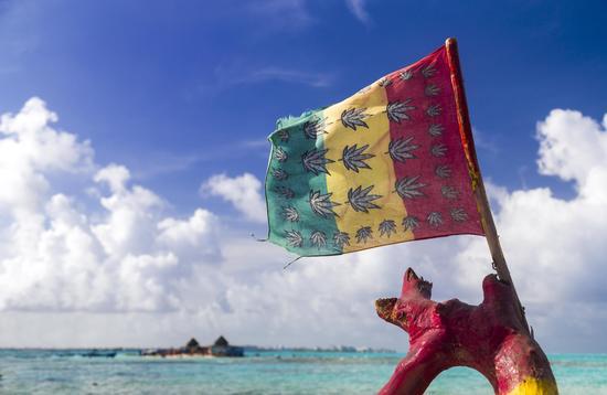 Cannabis flag at tropical beach
