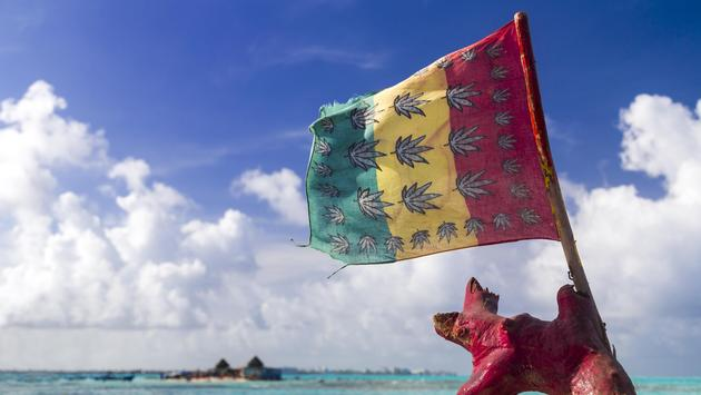 Cannabis flag at tropical beach