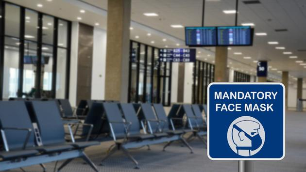 Sign for mandatory use of face mask in airport