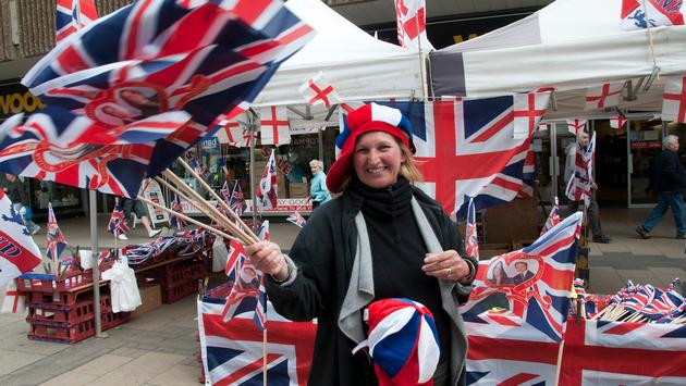 Vendor hawking merchandise commemorating Prince William and Catherine Middleton's royal wedding