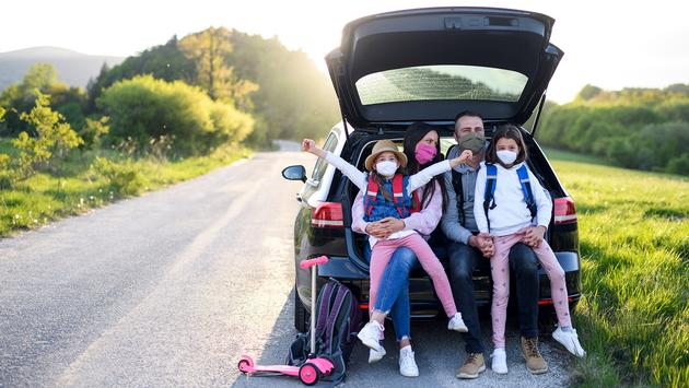 Family on a road trip in masks