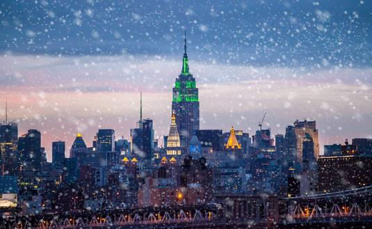 Snow falling on New York City.