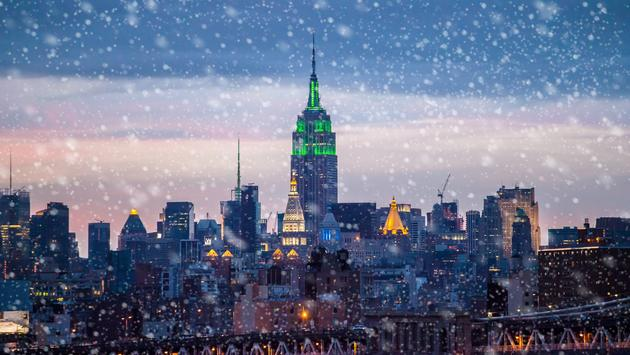 Snow falling on New York City.
