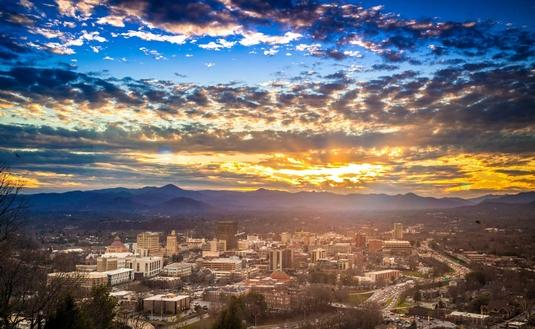 Downtown Asheville is flanked by the Blue Ridge Mountains.