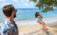 Having fun on a beach rope swing in Grenada