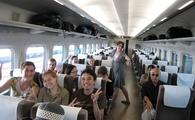 Group of travelers on a Tokyo Bullet Train