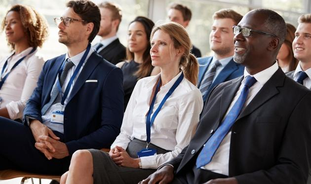 Audience listening in at a conference