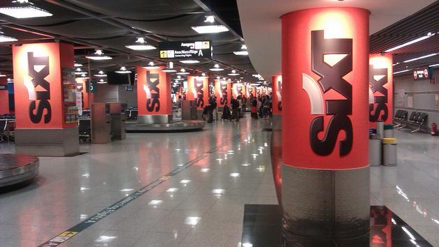 Sixt rental car logos in an airport