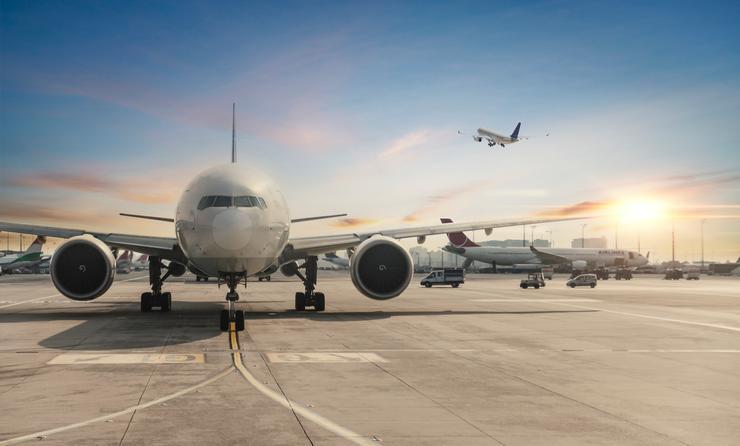 Passenger airplane sitting on the tarmac.