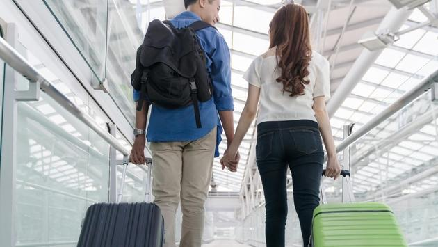 Couple carrying luggage