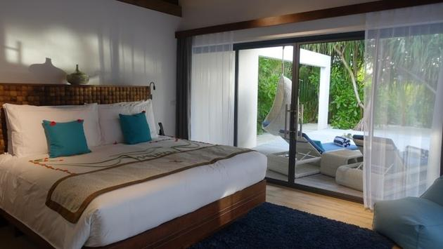 Guest room at Movenpick Resort Kuredhivaru in the Maldives
