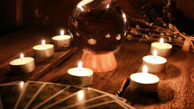 Divination ball lit by glowing candles