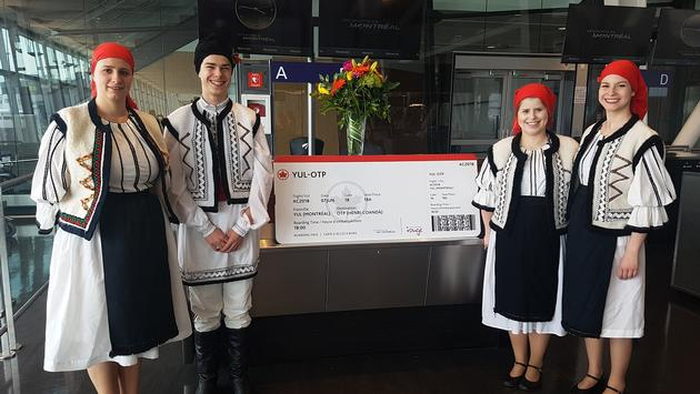 A Romanian dance troupe entertained passengers in the boarding lounge prior to the departure of Air Canada Rouge's inaugural flight to Bucharest.