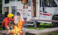 Family RV road trip campsite.